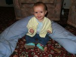 Wearing Daddy's sweater (boy, is it OLD!) @ 5.25 months